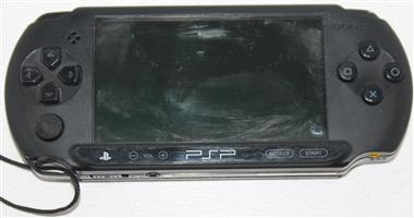 S034906A Sony psp with charger and game #Rosettenvillepawnshop