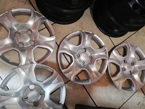 Ford rims with covers. (15inch)