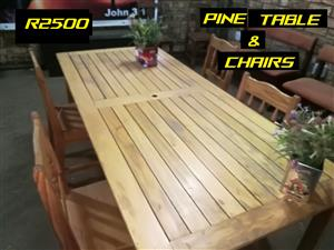 Beautiful pine table with four chairs.