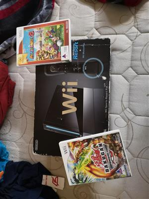 Nintendo wii complete with all cables 1 remote and 2 games included