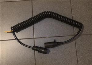Trailer lights coiled cable adapter from male South African type to male European type