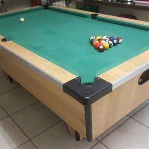 Pool table with accessories.