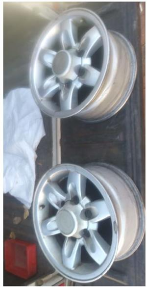 Nissan Hardbody Mag Rims 15 inch with Nissan centre caps