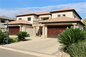 Power of Attorney Auction: Secure, spacious and modern 5 bedroom home within Ebotse Golf & Country Estate, Rynfield, GP