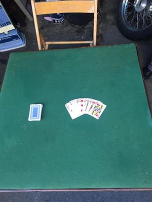 Poker table and wooden chair for sale