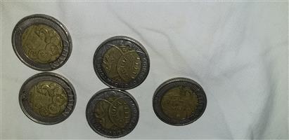 Selling Mandela coins.