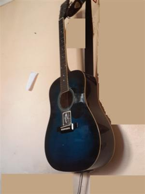 Acoustic Guitar Steel string Floencia with strap and stand.