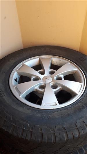 Mitsubishi Triton 16inch Rims and Tires with around 50% life