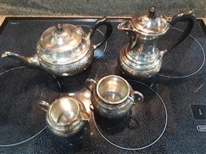 Silver plated tea set.  No. 3180 marking on all four items.  Good condition.