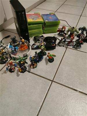 XBox360 consoles with games and figurines