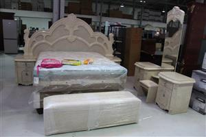 Light wooden bedroom set with foot stool