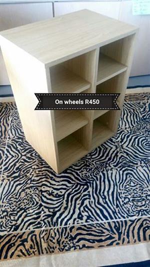 Light wooden shelf on wheels