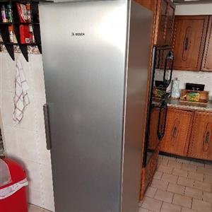 Silver Bosch upright fridge and upright freezer