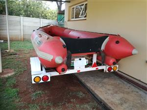 Gemini rubber duck with 25 Hp evenrude on a licensed trailer