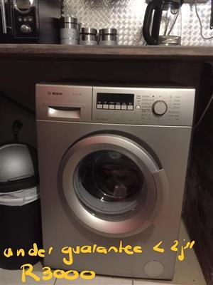 Dark silver Bosch front loader washing machine