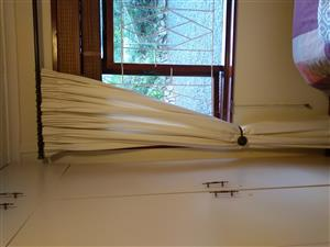 Curtains and accessories for sale.