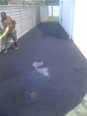 Hot asphalt tar surfacing and brick paving
