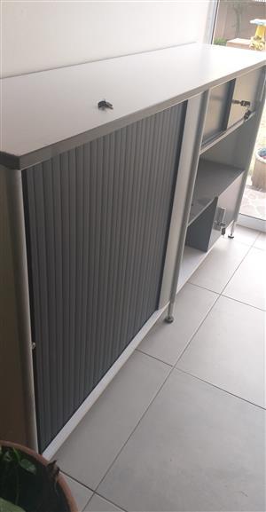 Cabinet with roller door