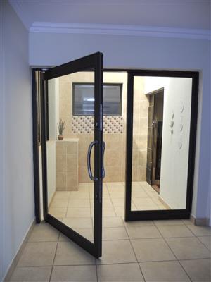 Aluminium Pivot Doors