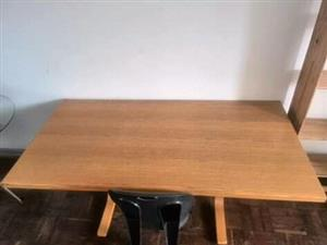 Light wooden desk and black chair