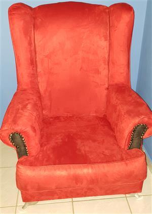 Red velvet wing back chair