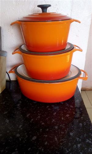 Selling 9 piece caster iron pots orange colour new