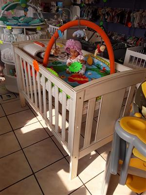 Beige crib with mobile for sale