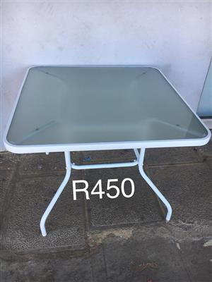 Patio table with glass top