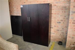 3 Door dark wooden closet for sale