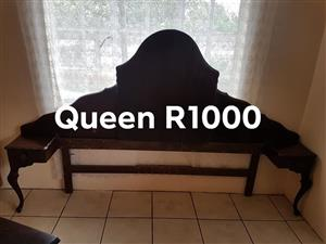 Queen dark wooden headboard