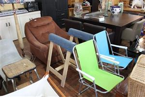 Brown 1 seater couch and wooden towel stands