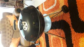 57 cm Weber Braai with new dust cover for sale.
