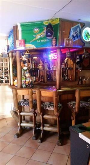 Wooden bar with chairs for sale