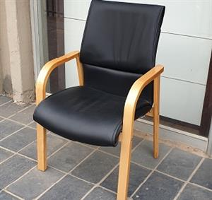 Pre-owned 4-Legged oak wood chairs in black PU leather