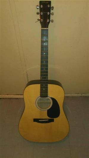 A western stagg guitar with bar and guitar tuner