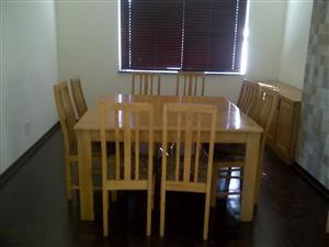Good solid Oak 8 seats dining table & Oak side board