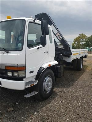 2008 Mitsubishi Fuso FM16-253 dropside with a cab mounted crane. Crane is HIAB 14T / meter crane