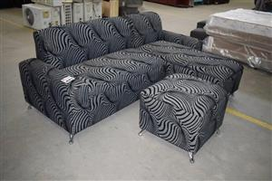 L Shaped grey zebra themed couch and ottoman