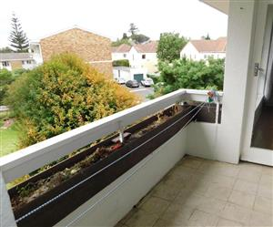 Near UCT / Damelin / Progress / Silwood. Top floor quiet, warm and secure apartment block with large communal garden views.