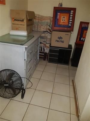 Large white drawer and desk fan