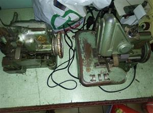 for sale is a Hemming Sewing Machine - Yamata model DCY-108 on bench with clutch motor plus an extra head all for 2500 rands