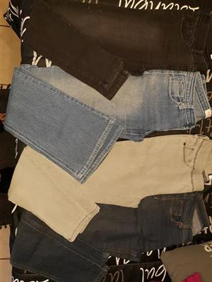 Various light and dark jeans for sale