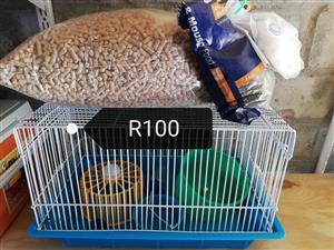 Hamster cage with food for sale