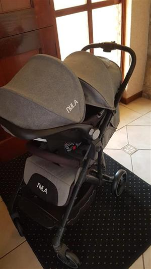 Nula pram with carseat (contact number in ad)
