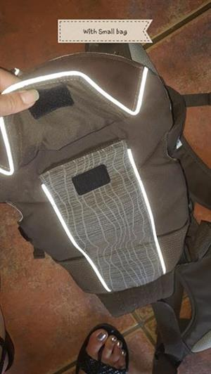 Strap carrier with bag for sale