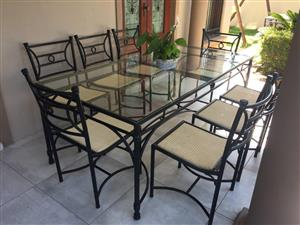 PATIO SET. STEEL/ALUMINIUM FRAME TABLE WITH 10mm SAFETY GLASS TOP & 8 x RATTAN CHAIRS. Wetherleys set.