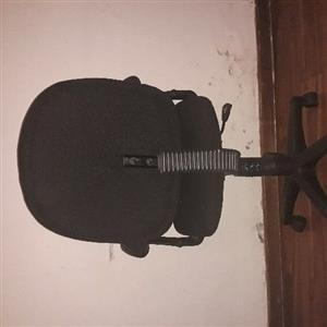 Black Meterial Office Chair On Wheels