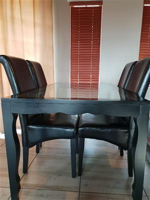 6 Seater Glass table and 4 chairs