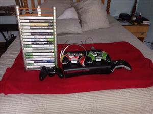 Xbox 360 + 4 Remote control's en 27 games