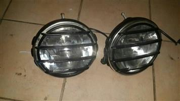 Spot  lights in good condition with black grill covers but needs mounts